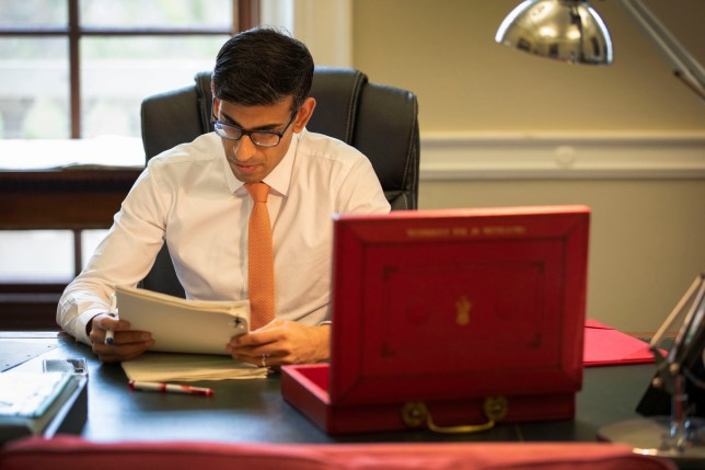 Handout photo issued by HM Treasury of Chancellor of the Exchequer Rishi Sunak making his final preparations to his first Budget speech in his office in the Palace of Westminster, London. PA Photo. Picture date: Tuesday March 10, 2020. See PA story POLITICS Budget. Photo credit should read: HM Treasury/PA Wire NOTE TO EDITORS: This handout photo may only be used in for editorial reporting purposes for the contemporaneous illustration of events, things or the people in the image or facts mentioned in the caption. Reuse of the picture may require further permission from the copyright holder.