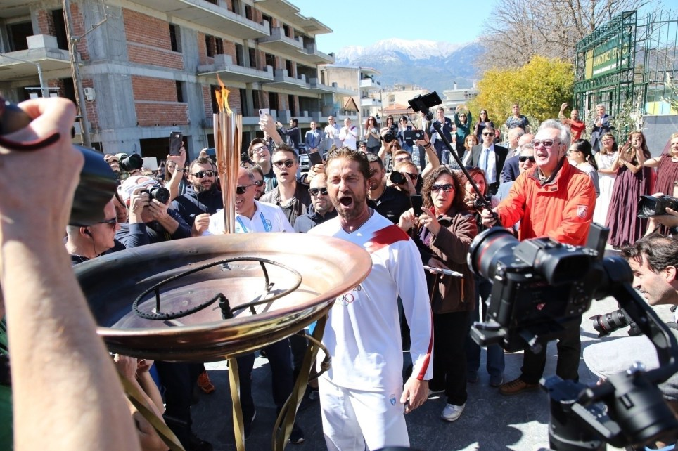 Starti, GREECE - Gerard Butler gets the honors to light the torch at the Olympic torch relay in Greece. Gerard dons a Tokyo 2020 shirt while attending aimed many concerns of canceling the 2020 Olympics in Tokyo due to the rise of Coronavirus worldwide. Pictured: Gerard Butler BACKGRID USA 13 MARCH 2020 BYLINE MUST READ: karabatsispavlos / BACKGRID USA: +1 310 798 9111 / usasales@backgrid.com UK: +44 208 344 2007 / uksales@backgrid.com *UK Clients - Pictures Containing Children Please Pixelate Face Prior To Publication*