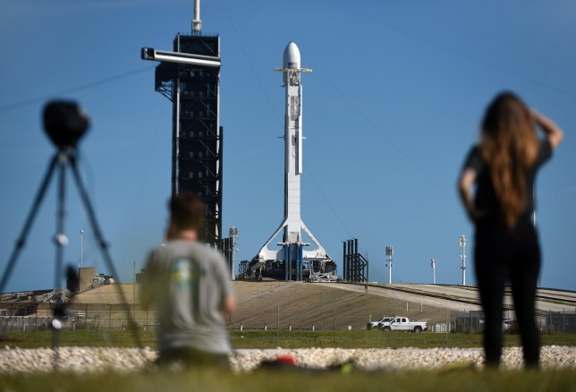 A SpaceX Falcon 9 rocket carrying the sixth batch of Starlink satellites for a planned constellation to provide broadband internet service stands ready for launch tomorrow at Space Launch Complex 39A on March 14, 2020 at the Kennedy Space Center in Cape Canaveral, Florida, US. (Photo by Paul Hennessy/NurPhoto)