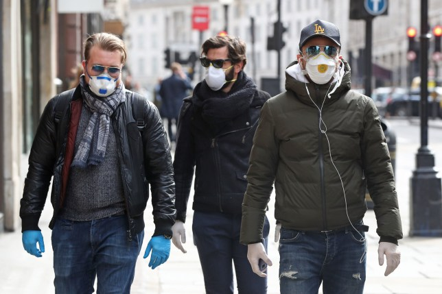 People wearing face masks and gloves in Regents Street in London the day after Prime Minister Boris Johnson called on people to stay away from pubs, clubs and theatres, work from home if possible and avoid all non-essential contacts and travel in order to reduce the impact of the coronavirus pandemic. PA Photo. Picture date: Tuesday March 17, 2020. See PA story HEALTH Coronavirus. Photo credit should read: Jonathan Brady/PA Wire