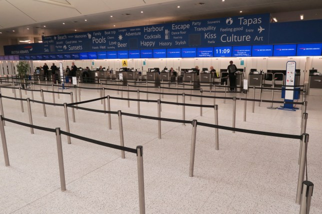 LONDON, UNITED KINGDOM - MARCH 17: British Airways check in desks have no queues on March 17, 2020 in Gatwick, United Kingdom. Several UK and European carriers are reducing staff and practically grounding their fleets as governments worldwide impose travel restrictions to curb the spread of COVID-19. (Photo by Mike Hewitt/Getty Images)