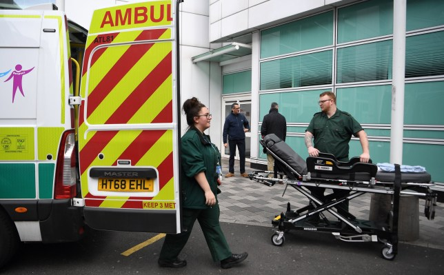 epa08308900 National Health Service (NHS) employees work outside a hospital in London, Britain, 20 March 2020. According to news reports, the NHS is planning to increase testing for people suffering from symptoms akin to those of the COVID-19 disease caused by the SARS-CoV-2 coronavirus. The NHS will reportedly be able to carry out around 10,000 tests per day. EPA/ANDY RAIN
