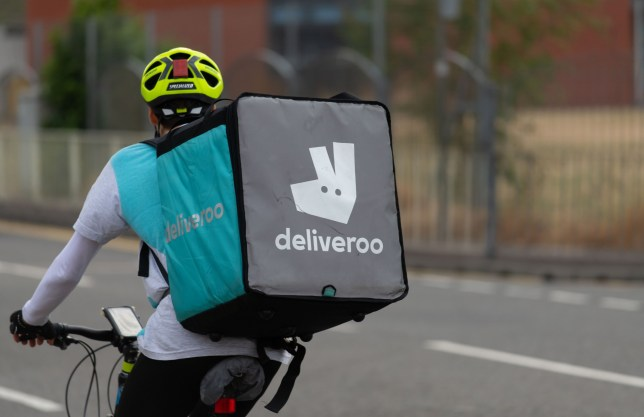 CARDIFF, UNITED KINGDOM - JULY 01: A Deliveroo food delivery rider on July 01, 2018 in Cardiff, United Kingdom. Deliveroo is calling on the government for a charter to allow gig economy platforms to provide benefits to freelancers without their employment status changing. (Photo by Matthew Horwood/Getty Images)