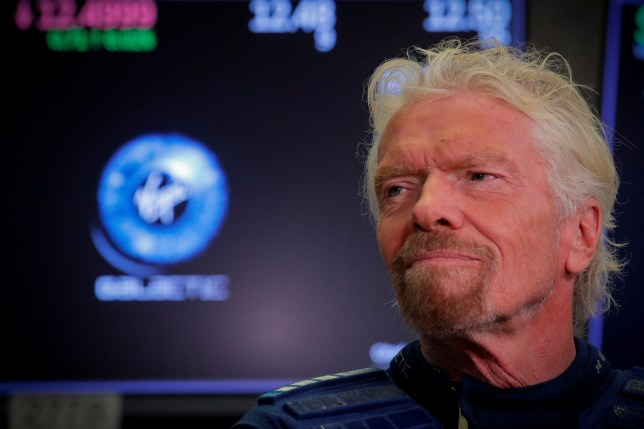 Sir Richard Branson stands on the floor of the New York Stock Exchange