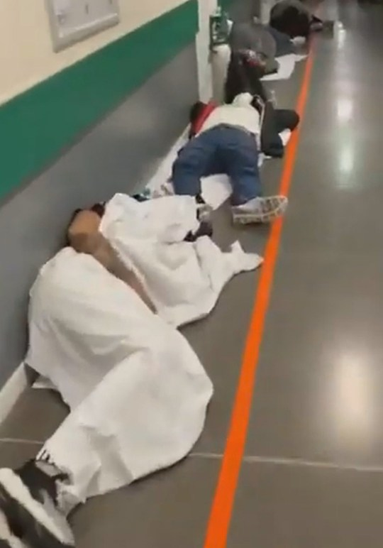 Pic shows: The emergency room of the hospital Infanta Leonor in Madrid. These startling images show patients lying on the floor in packed Madrid hospitals as the city is overrun with coronavirus cases.