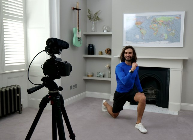 LONDON, ENGLAND - MARCH 23: Joe Wicks, aka The Body Coach, teaches the UK's school children physical education live via YouTube on March 23, 2020 from his home in London, England. Joe took to YouTube Live in response to the Covid-19 pandemic which has seen school children around the UK sent home. To keep the nations children active Joe will be teaching PE lesson's every week day from 9AM this week. (Photo by The Body Coach via Getty Images)