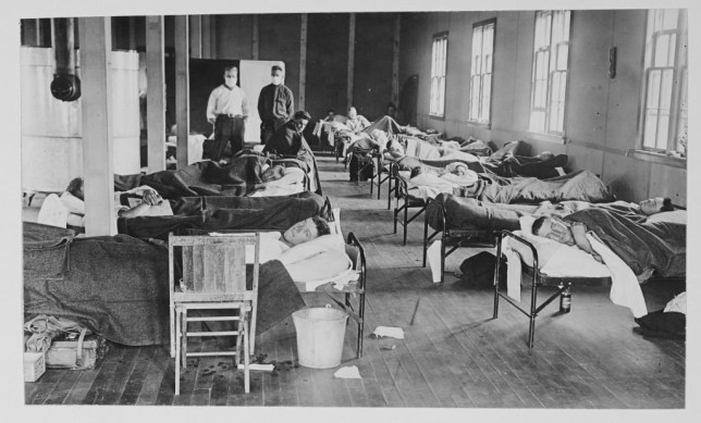 View of victims of the Spanish flu cases as they lie in beads at a barracks hospital on the campus of Colorado Agricultural College, Fort Collins, Colorado, 1918. (Photo by American Unofficial Collection of World War I Photographs/PhotoQuest/Getty Images)