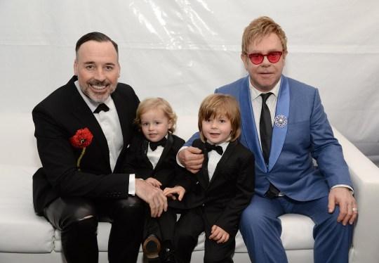 David Furnish, Elijah Furnish-John, Zachary Furnish-John, and Sir Elton John attend the 23rd Annual Elton John AIDS Foundation Academy Awards
