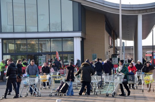 Dated: 25/03/2020 Early morning shoppers queue outside waiting for the Morrisons supermarket to open in Byker, Newcastle upon Tyne, this morning (WED), with the public being advised to stay at home to help curb the spread of the coronavirus outbreak.