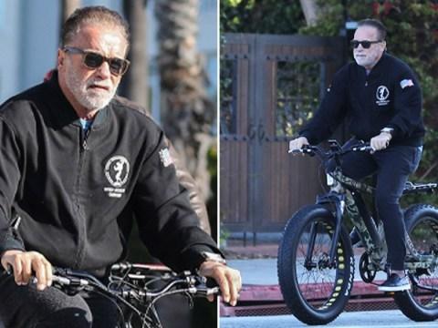 Arnold Schwarzenegger takes a break from lockdown for bike ride after donating $1million