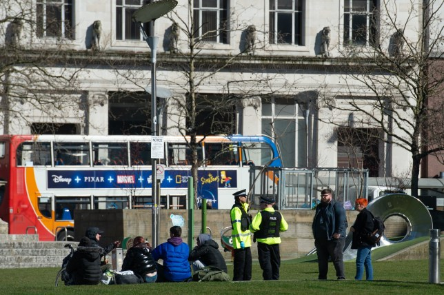 Police officers talk to a group in Piccadilly Gardens in Manchester city centre. The COVID-19 coronavirus pandemic has resulted in a government-ordered shutdown. (Thursday 26th March 2020). Disclaimer: While Cavendish Press (Manchester) Ltd uses its' best endeavours to establish the copyright and authenticity of all pictures supplied, it accepts no liability for any damage, loss or legal action caused by the use of images supplied. The publication of images is solely at your discretion. For terms and conditions see http://www.cavendish-press.co.uk/pages/terms-and-conditions.aspx