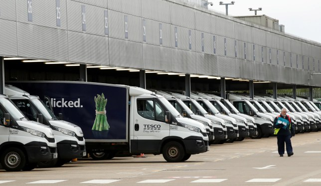 FILE PHOTO: General view of Tesco delivery vans at a depot in Enfield as the spread of the coronavirus disease (COVID-19) continues, in London, Britain, March 18, 2020. REUTERS/Matthew Childs/File Photo