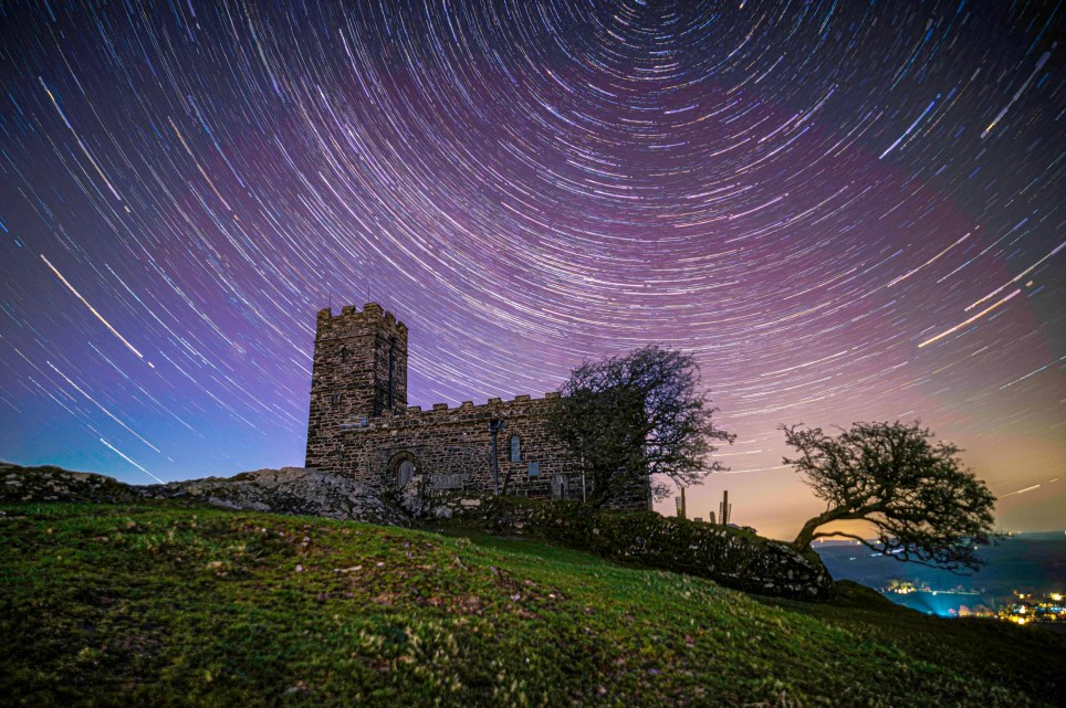 Incredible images of starry skies above Britain captured by West Country based snapper Warren Wise. The images were taken by St Michael???s Church at Brentor, near Tavistock, Devon, so there is little light pollution. TRIANGLE NEWS 0203 176 5581 // contact@trianglenews.co.uk By Ralph Blackburn THESE incredible images show a rarely-seen completely clear and starry sky above Britain. Snapper Warren Wise made the most of the good weather and plane-free skies to capture these beautiful photographs. It was the last time the 40-year-old left his house in Cornwall, before going into isolation due to the coronavirus. The keen photographer spent four hours over three nights snapping the skies by St Michael???s Church at Brentor, near Tavistock, Devon. The church is on the edge of Dartmoor National Park, so there is little light pollution.