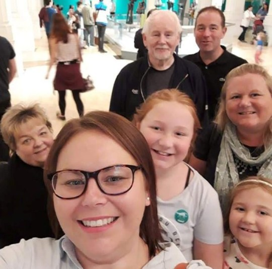 Susan Nelson far left with family. See SWNS story SWMDfamily; The children of a beloved mum, who died after contracting Coronavirus, believe that up to 17 wider family members have been infected Covid-19 after they all attended a funeral. Susan Nelson, 65, who had no underlying health conditions, died at the Queen Elizabeth Hospital in Birmingham with her husband Robert, 67, at her side.The retired grandmother, who ran a family catering business and a sandwich shop in her native Halesowen, West Mids., displayed symptoms after her aunt?s funeral on Friday March 13. Her condition got notably worse the following week, with the family forced into calling an ambulance. Her son Carl, 42, who now lives in Cleckheaton, Yorks., said: ?She was coughing a lot, very breathless and showing all the traditional symptoms. ?She was admitted to hospital on Monday (16/03) and I spoke to the hospital staff the following day. ?They said the next 48 hours were critical before they called me back a few hours later to say it was very close to the end and one member of the family could be with her.