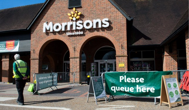 Mandatory Credit: Photo by Ian Tuttle/REX (10596934v) A queue outside Morrisons supermarket due to Covid-19 Coronavirus Outbreak, Surrey, UK - 29 Mar 2020