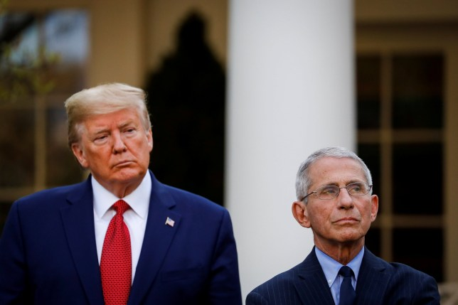 U.S. President Donald Trump and NIH National Institute of Allergy and Infectious Diseases Director Anthony Fauci listen during a news conference in the Rose Garden of the White House in Washington, U.S., March 29, 2020. REUTERS/Al Drago