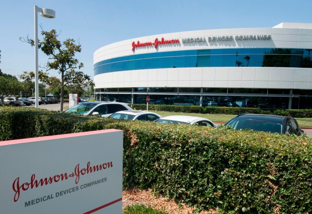 An entry sign to the Johnson & Johnson campus shows their logo in Irvine, California on August 28, 2019. - The US pharmaceutical industry faces tens of billions of dollars in potential damage payments for fueling the opioid addiction crisis after Oklahoma won a $572 million judgment against drugmaker Johnson & Johnson. (Photo by Mark RALSTON / AFP) (Photo credit should read MARK RALSTON/AFP via Getty Images)