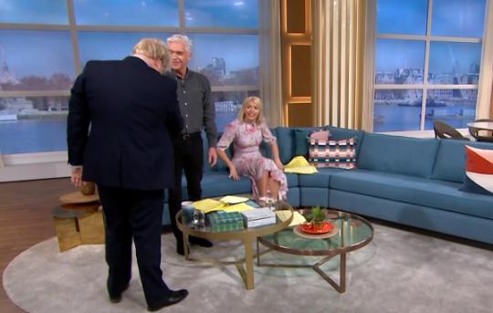 Phillip Schofield tries to dodge  Boris Johnson's handshake amid coronavirus fears: 'I kept my hands by my side'