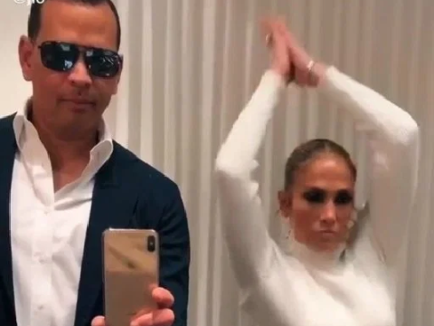 Jennifer Lopez lends skintight white dress to boyfriend Alex Rodriguez as they nail viral 'flip challenge'