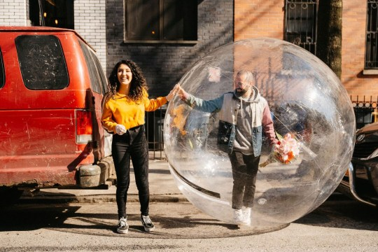man in bubble while on date