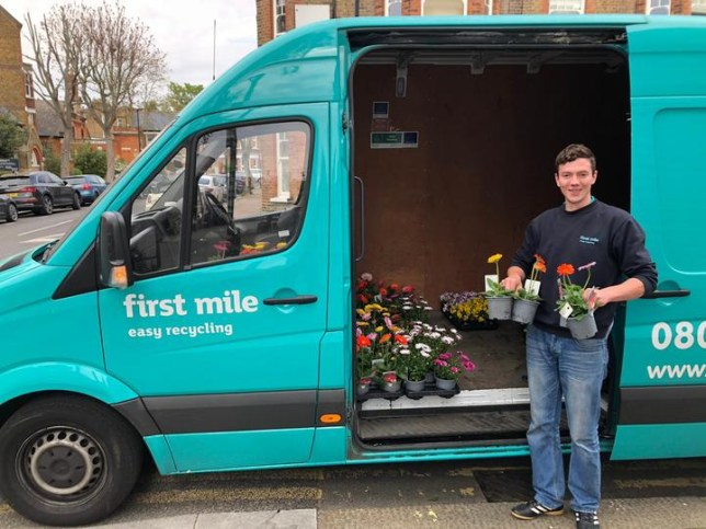 Delivery driver Doru Lukasz standing in front of the van and holding plants