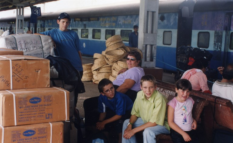 Paul and Rob Forkan as kids with their family at a train station.