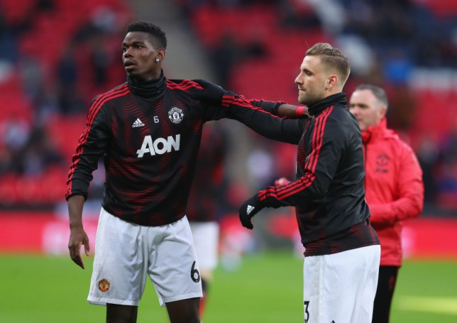 LONDON, ENGLAND - JANUARY 13:  Paul Pogba and Luke Shaw of Manchester United warm up prior to the Premier League match between Tottenham Hotspur and Manchester United at Wembley Stadium on January 13, 2019 in London, United Kingdom.  (Photo by Catherine Ivill/Getty Images)