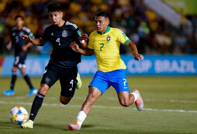 Alejandro Gomez and Gabriel Veron (R) battle for the ball