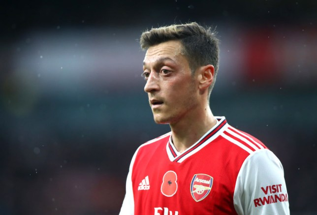 Mesut Ozil refused to take a pay cut (Picture: Getty)