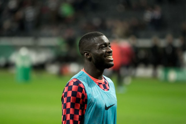 Dayot Upamecano warms up for RB Leipzig