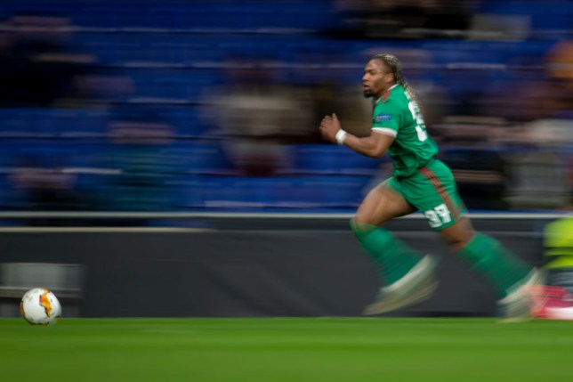Adama Traore is pictured running at full speed for Wolves during a game