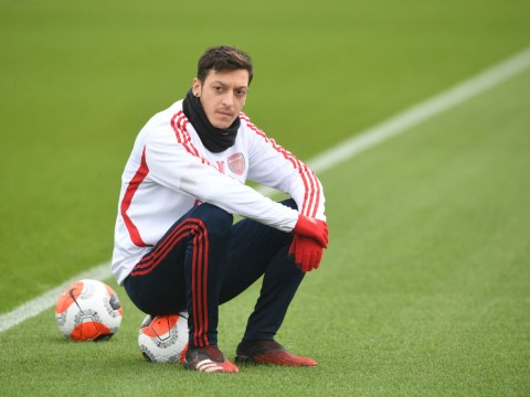 Gary Neville accuses Arsenal players of 'outing' Mesut Ozil and questions his future at the club