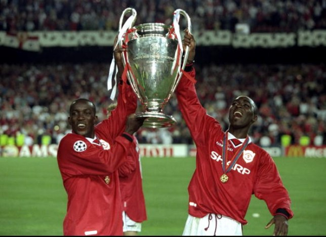 26 May 1999:  Dwight Yorke and Andy Cole of Manchester United lift the trophy after a 2-1 victory over Bayern Munich in the UEFA Champions League Final at the Nou Camp in Barcelona, Spain.   Mandatory Credit: Alex Livesey /Allsport (Credits: Getty Images)