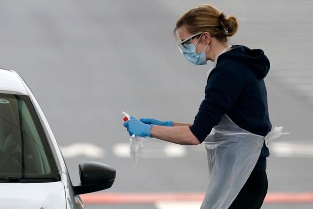 woman at a drive through coronavirus test centre