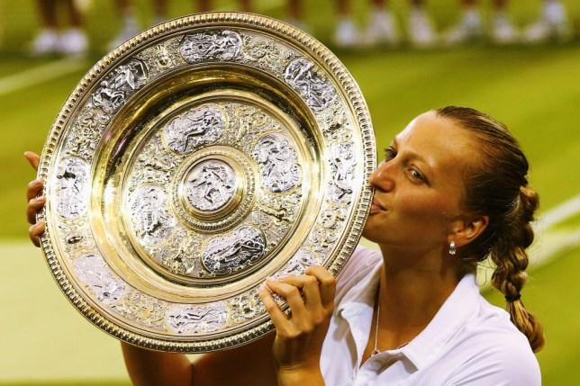 Petra Kvitova poses after winning Wimbledon