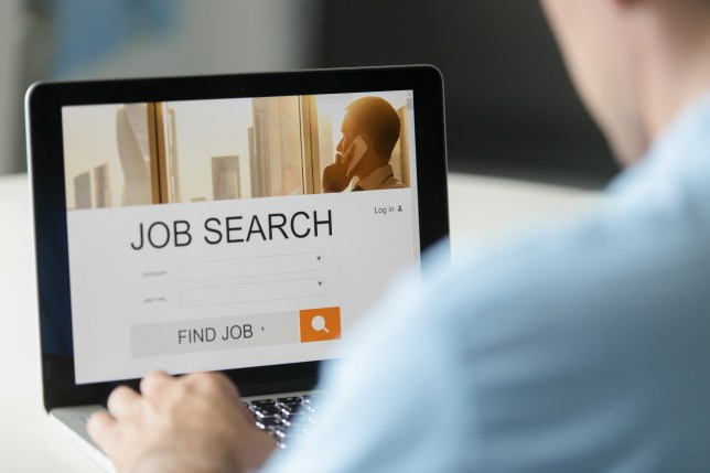 Monitor view over a male shoulder, job search title