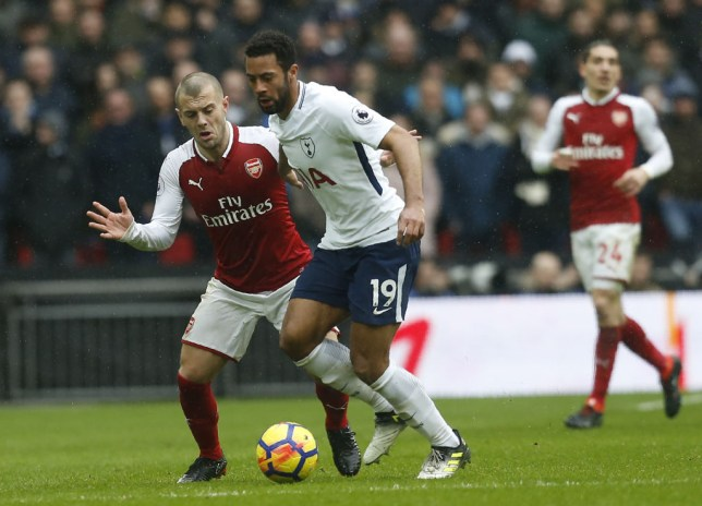 Jack Wilshere competes for the ball with Moussa Dembele during Arsenal's Premier League clash with Tottenham