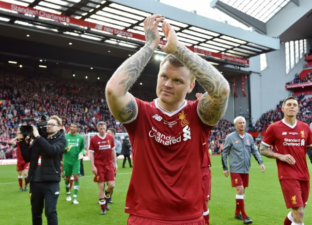 John Arne Riise applauds the Liverpool fans after a charity game