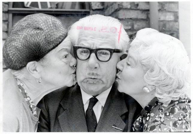 Albert Tatlock (Joack Howarth) receives a kiss on each cheek by Ena Sharples (Violet Carson ) (l) and Beattie Pearson (Gabrielle Daye) (r).