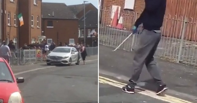 Footage appears to show men walking along Friendly Street, Belfast, holding knives and metal poles