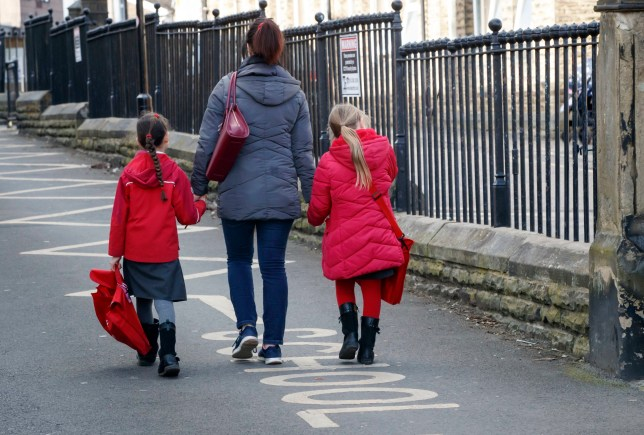 Children leaving a school in Leeds following the Government announcement that all schools in England will close on Friday due to the Coronavirus pandemic. PA Photo. Picture date: Friday March 20, 2020. See PA story HEALTH Coronavirus. Photo credit should read: Danny Lawson/PA Wire