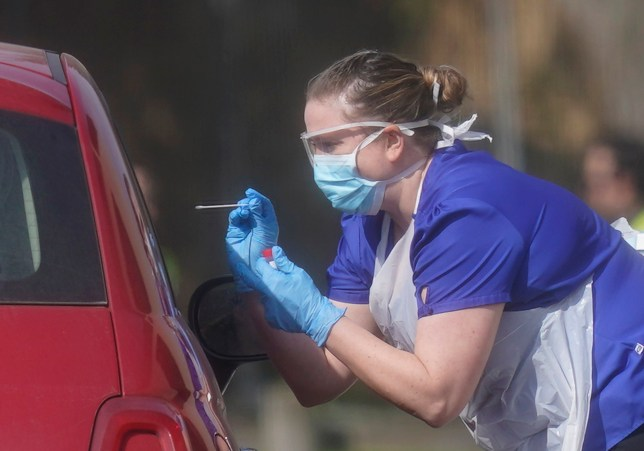 An NHS worker being tested for coronavirus at a temporary drive through testing station