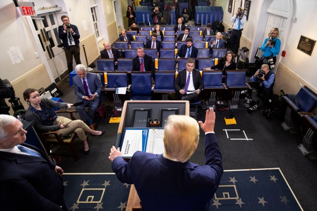 President Donald Trump waves as he departs after speakin about the coronavirus, with Vice President Mike Pence at left, in the James Brady Press Briefing Room of the White House, Tuesday, March 31, 2020, in Washington. (AP Photo/Alex Brandon)