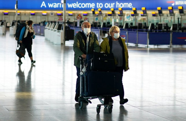 Passengers at Heathrow Airport in London