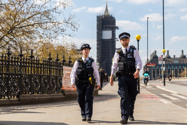 epa08348336 Police officers walk across Westminster Bridge towards St.Thomas' Hospital in London, Britain, 07 April, 2020. British Prime Minister Boris Johnson is being treated for Coronavirus at St. Thomas' Hospital, and was moved to the Intensive Care Unit after his condition worsened. Countries around the world are taking increased measures to stem the widespread of the SARS-CoV-2 coronavirus which causes the Covid-19 disease. EPA/VICKIE FLORES