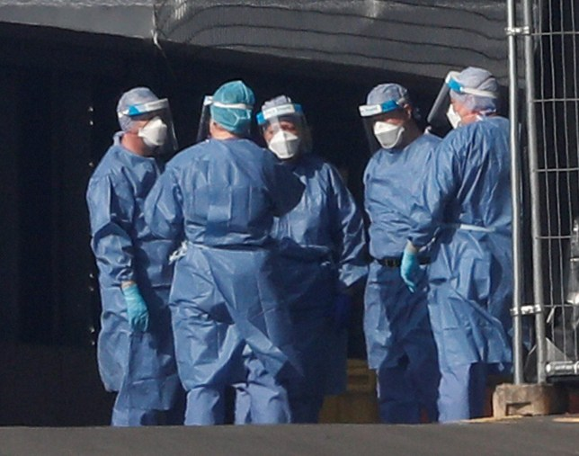 Medical staff are seen wearing PPE clothing outside the NHS Nightingale Hospital at the Excel Centre, London, Britain April 9, 2020. REUTERS/Matthew Childs