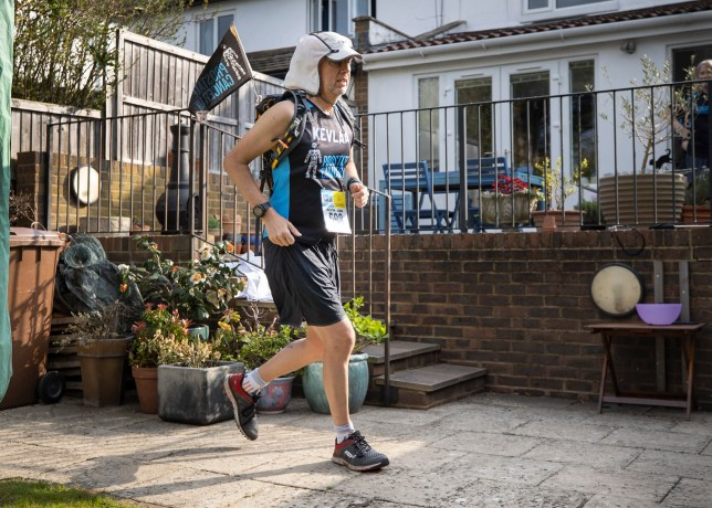 ? Licensed to London News Pictures. 11/04/2020. Stoneleigh, UK. Kevin Webber completes the last equivalent Stage of the Marathon des Sables ultramarathon in his Surrey garden during lockdown. Kevin has run the entire 230Km (143 miles) 6 stage race in his small back and front gardens, completing 2734 laps, over 6 days - finishing today. Kevin, who was diagnosed with terminal prostate cancer just over 5 years ago was due to take part in his 5th consecutive running of what is described as the 'toughest foot race on Earth' through the Sahara Desert in Southern Morocco this month, but the 2020 six day race has been postponed until September. Kevin is raising funds for the National Emergencies Trust Coronavirus Appeal who will distribute the funds to where they are needed most in the UK and he will jointly split what he raises with Prostate Cancer UK. Photo credit: Peter Macdiarmid/LNP