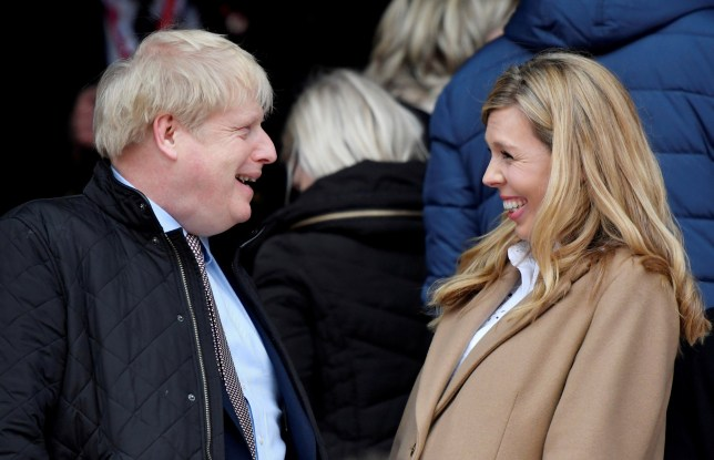 FILE PHOTO: Rugby Union - Six Nations Championship - England v Wales - Twickenham Stadium, London, Britain - March 7, 2020 Britain's Prime Minister Boris Johnson with his partner Carrie Symonds before the match REUTERS/Toby Melville/File Photo