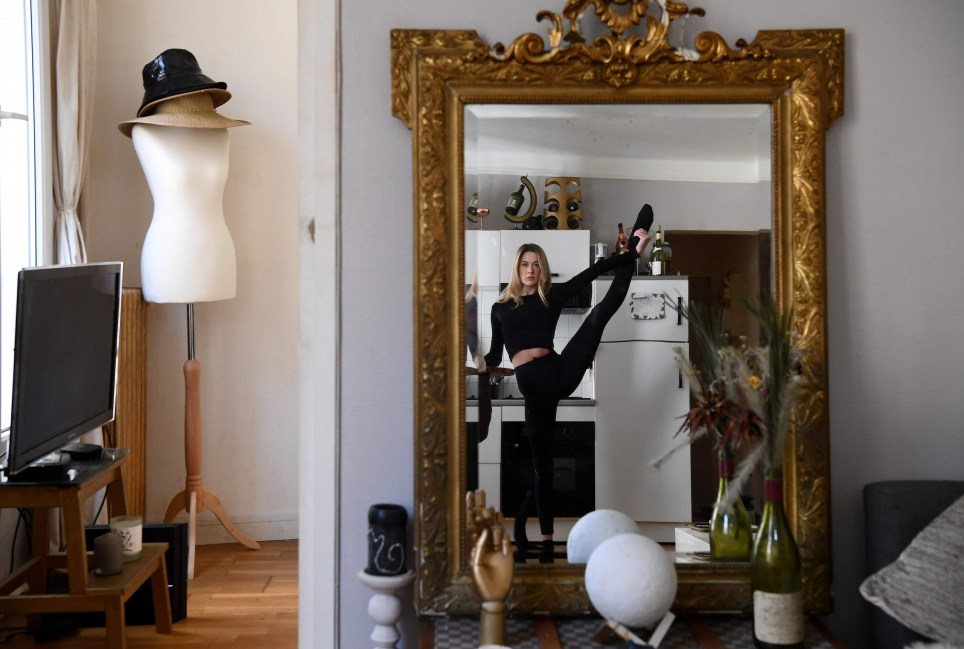 Irish dancer from the Moulin Rouge, Isabelle, practices at home in Paris on April 14, 2020, on the 29th day of a strict lockdown aimed at curbing the spread of the COVID-19 pandemic, caused by the novel coronavirus. (Photo by FRANCK FIFE / AFP) (Photo by FRANCK FIFE/AFP via Getty Images)