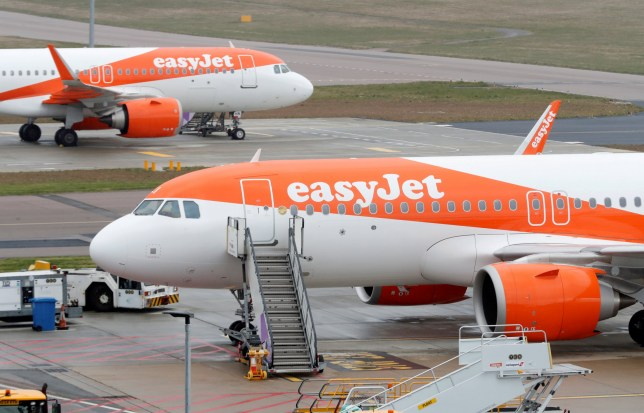 FILE PHOTO: EasyJet planes are seen parked at Luton airport after the airline announced it has grounded its entire fleet as the spread of the coronavirus disease (COVID-19) continues, Luton, Britain, March 30, 2020. REUTERS/Matthew Childs/File Photo